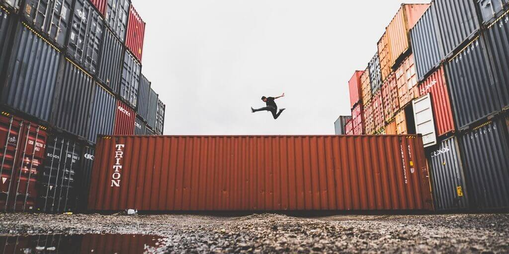 Passing config values to Docker containers using environment variables