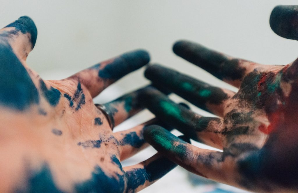 dirty hands covered in paint